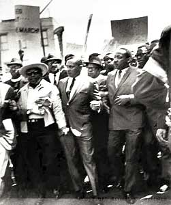 Rev. King marches with striking sanitation workers in Memphis on March 28, 1968.