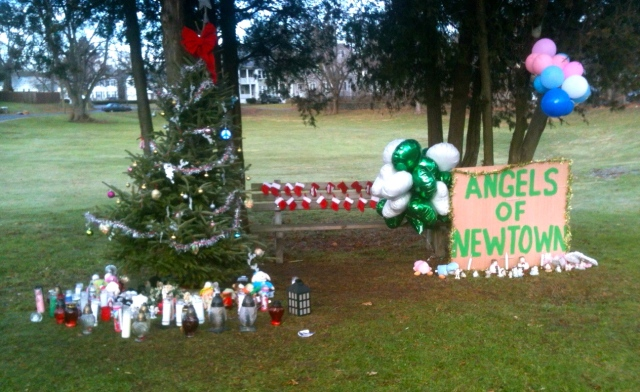 "A memorial for victims of the Sandy Hook shootings at the ""little"" park, corner of Roxbury Road and Stanley Street."