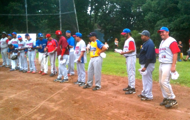 The line up of New Britain's Playeros team are introduced before the softball game with Merengueros. Playeros will travel to Santa Isabel, Puerto Rico as part of a friendship series.