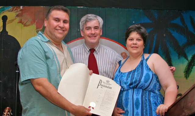 Mayor O'Brien presents State Rep. Bobby Sanchez with his Proclamation.  At left is Sanchez' wife Nebeska.