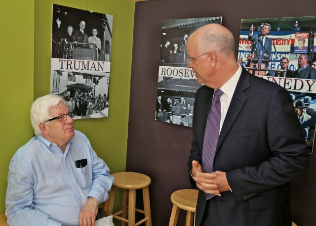 Frank Self and State Comptroller Kevin Lembo. Historic photos are from Dr. Frank Gerratana's collection of his father's photojournalism.