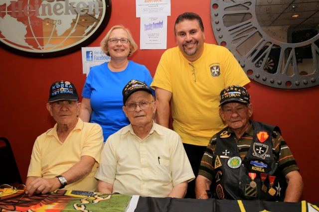 Joined by veterans and members of the 25th Borinqueneers (front row) State Senator Terry Gerratana (back left) and State Rep. Bobby Sanchez supported the first fundraiser to establish a Memorial Park for the famed 65th Infantry Regiment of Puerto Rican soldiers. The event was held at the Frosty Mug near the monument site at Beaver Street and Farmington Avenue. (F. Gerratana photo)