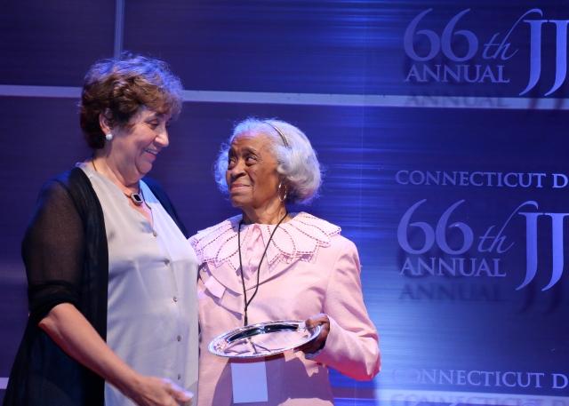 State Party Chair Nancy DiNardo presents Governor O'Neill Award to Emma Pierce.
