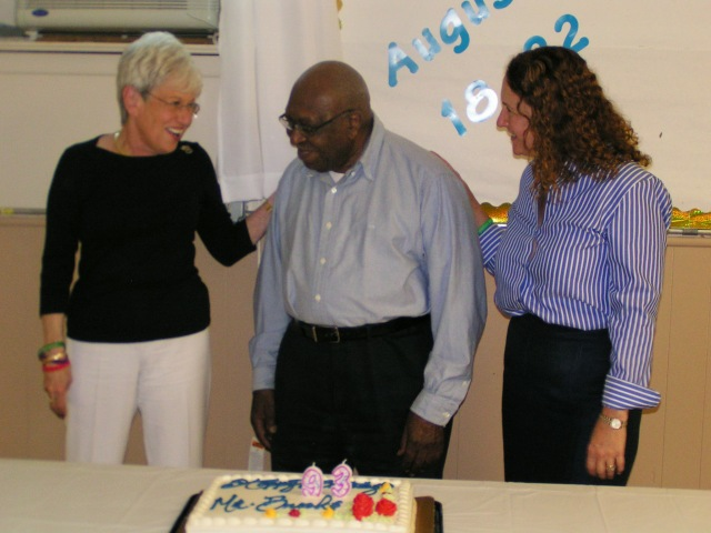 """Lt. Governor Wyman, Alton Brooks and Cong Esty before attendees seranaded Brooks with """"Happy Birthday."""""""