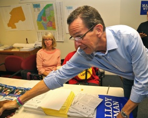 Governor Malloy greets campaign volunteers at Democratic headquarters.