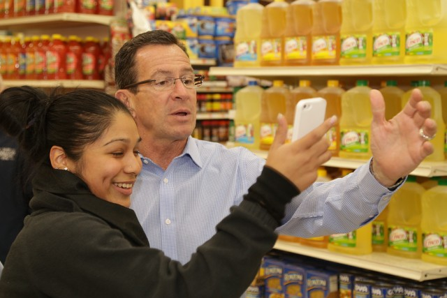 Malloy stops for selfie with shopper at C-Town November 4th (F. Gerratana photo)