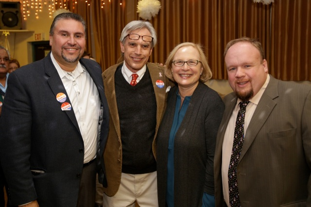 Four members of the city's legislative delegation celebrate a victory at the Pulaski Club on Election night. They begin their new term this week, From left Rep. Bobby Sanchez (25), Rep Peter Tercyak (26), State Senator Terry Gerratana (6) and State Rep. Rick Lopes (24). Rep. Betty Boukus (22), representing  the DiLoreto School district in the city, celebrated her big win at Plainville Democratic headquarters. (F. Gerratana photo)