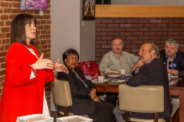 DNC Official Amy Dacey speaks to local Democrats about ethnic voter engagement and immigration reform on Broad Street, Saturday, April 23rd. (F. Gerratana photo)